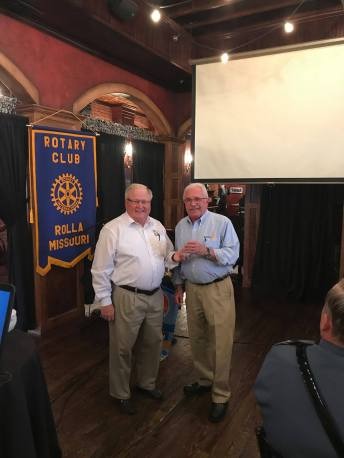At a recent meeting, pediatric nephrologist (children's kidney specialist) and Rotary guest Dr. Ted Groshong updates Rotary Club of Rolla on the impact of the global effort to eradicate polio.
