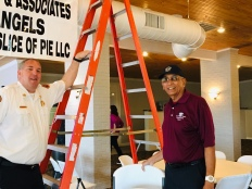 Ron and Bob bask in sign-hanging success!